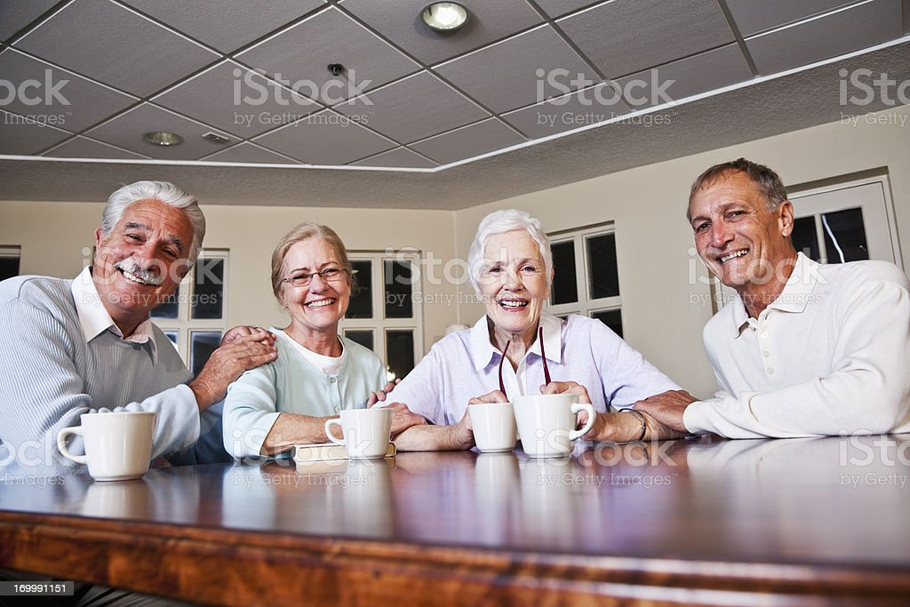 Senior couples drinking coffee royalty-free stock photo