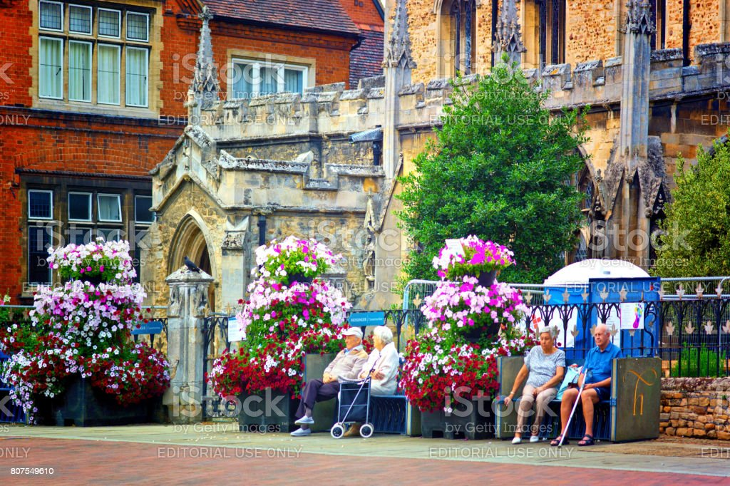 Senior couples outside a church stock photo