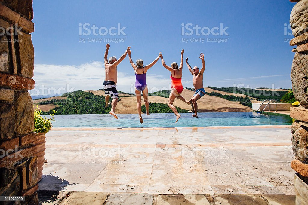 Senior Couples Taking a Big Leap Together! stock photo