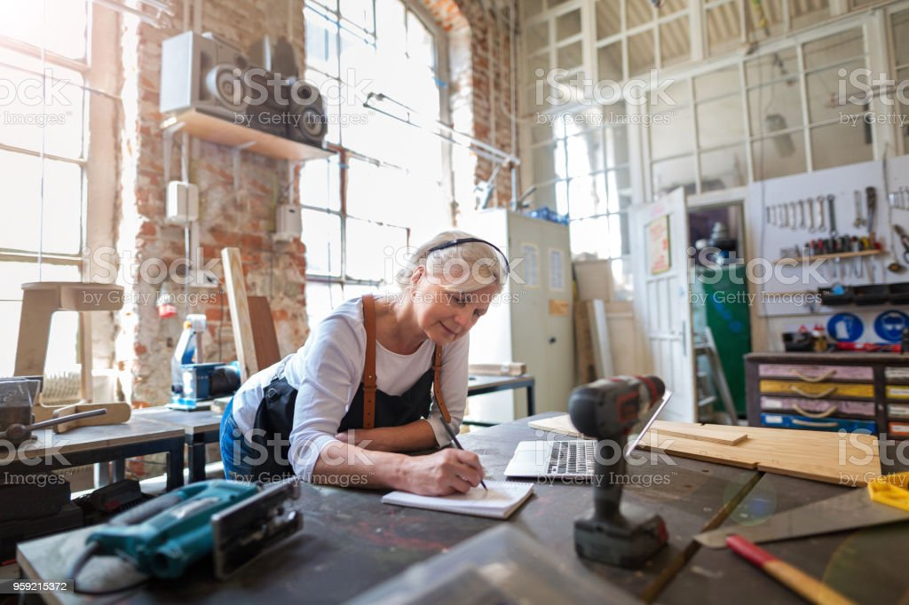 Senior craftswoman in her workshop stock photo