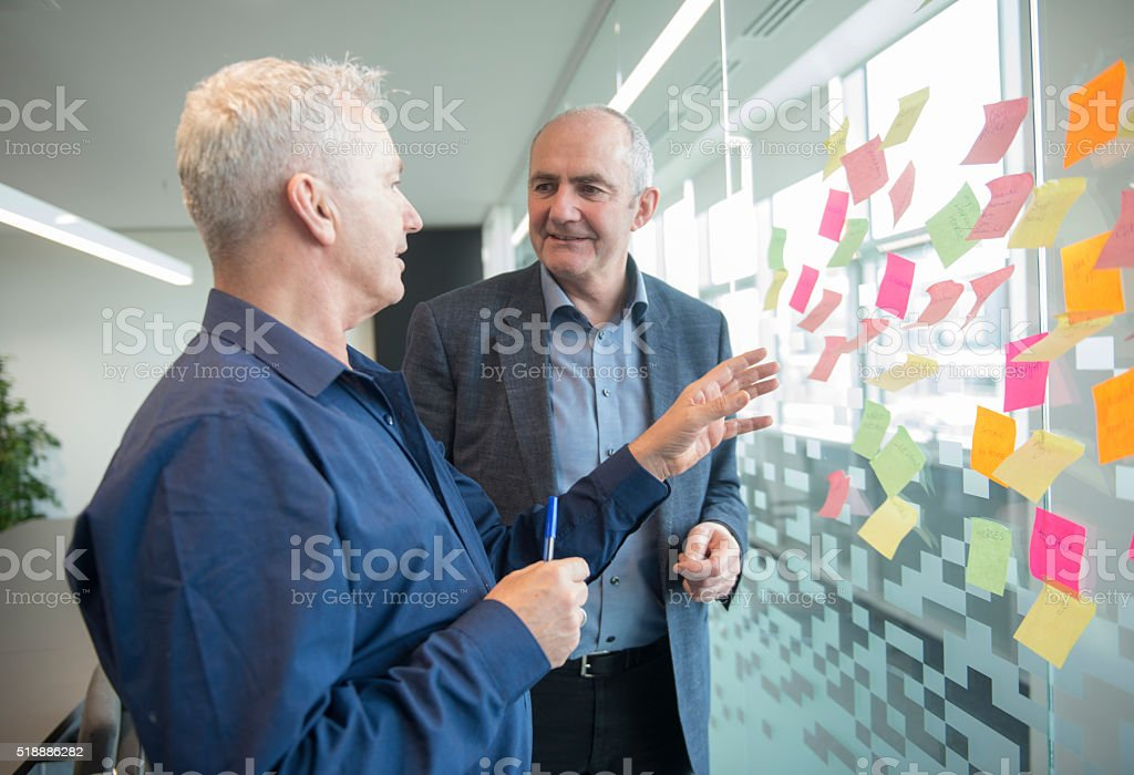 Senior Creatives in office stock photo
