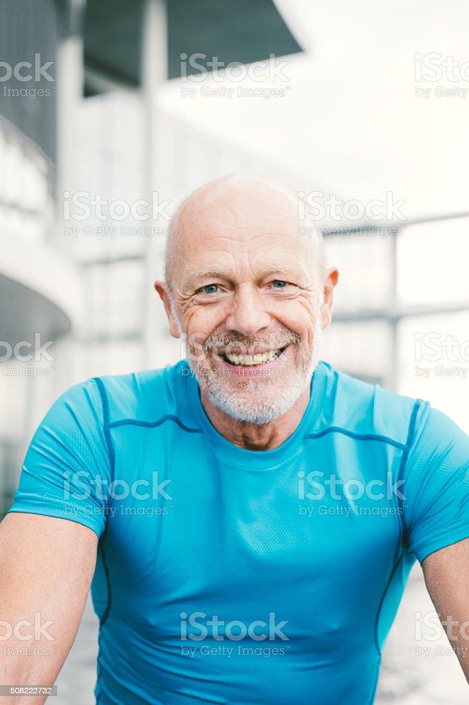 Senior Cyclist In A City Street stock photo