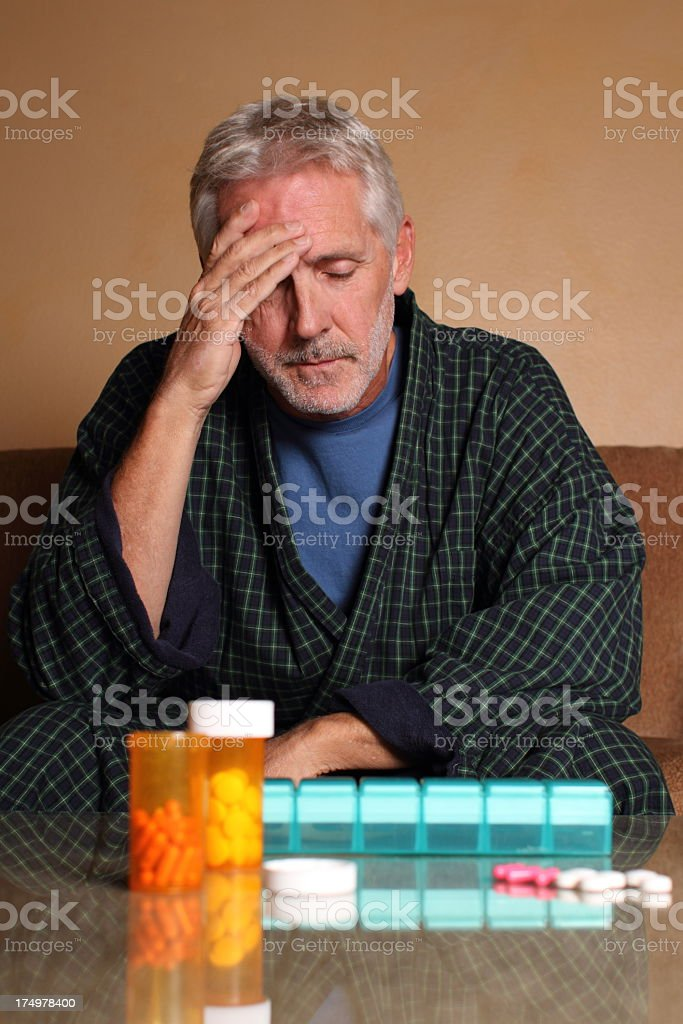 Senior Depressed Man Headache Over Medication royalty-free stock photo