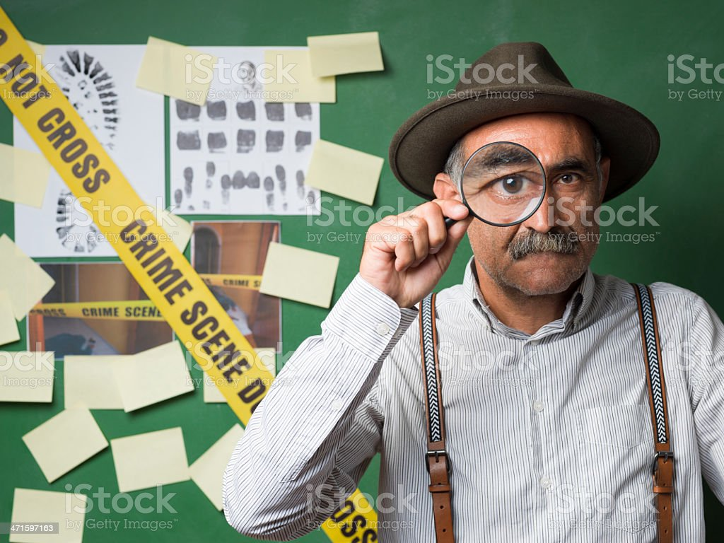 Senior detective holding magnifier glass royalty-free stock photo