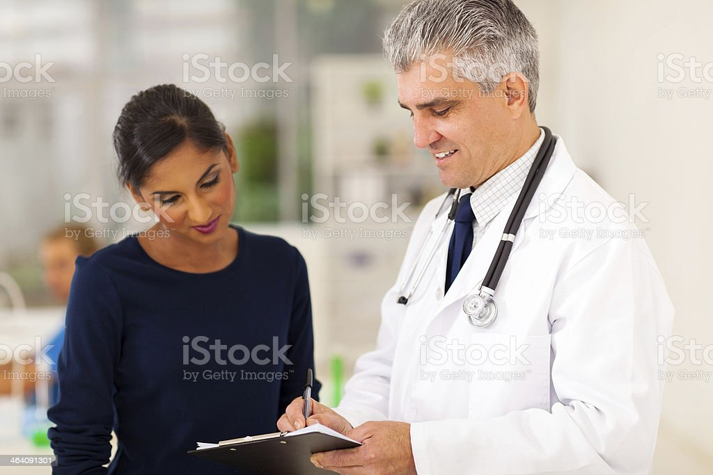 senior doctor checking patient's test result stock photo