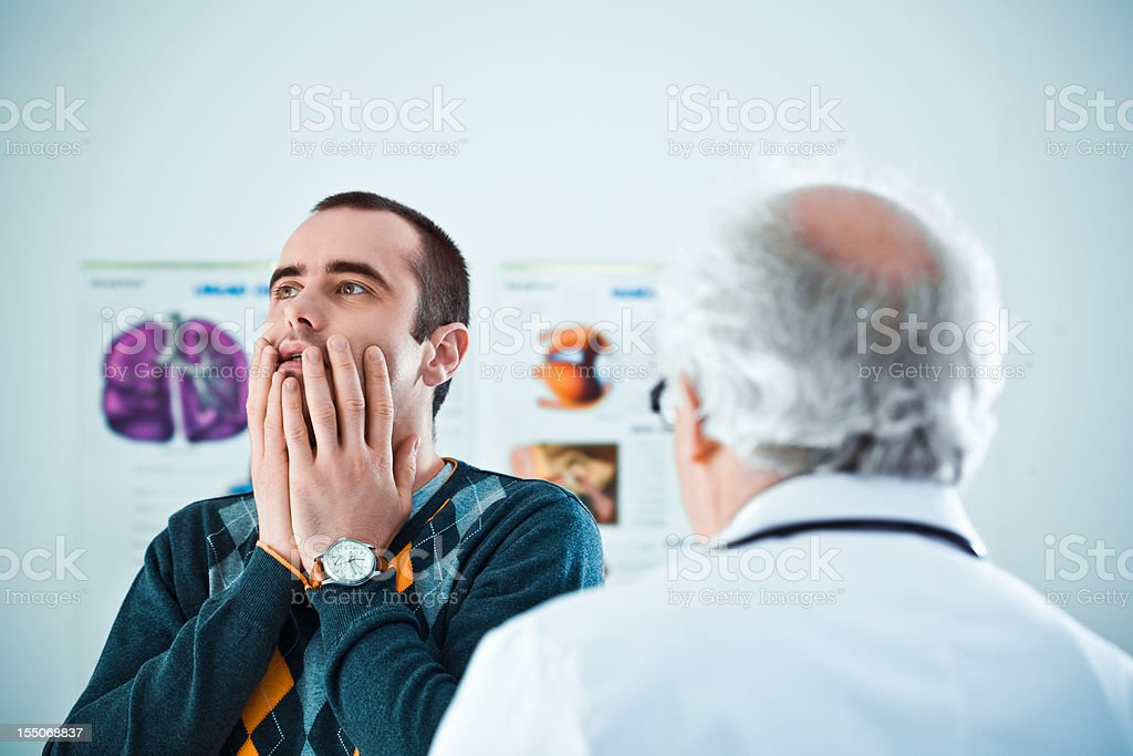 Senior doctor giving bad news royalty-free stock photo