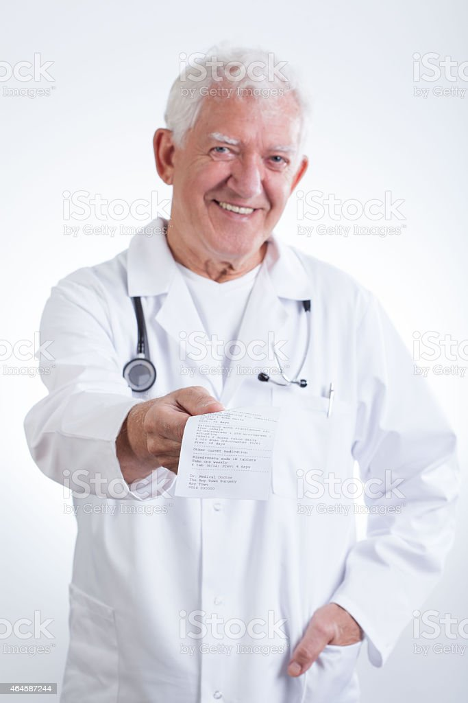 Senior doctor giving prescription stock photo