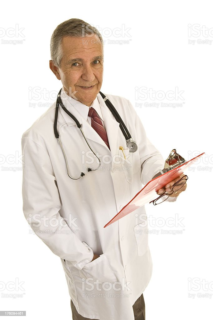 Senior doctor holding file hand in pocket looking at camera royalty-free stock photo