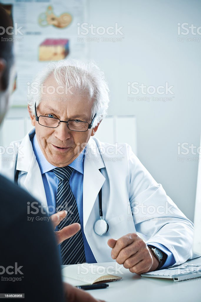 Senior doctor talking to patient royalty-free stock photo