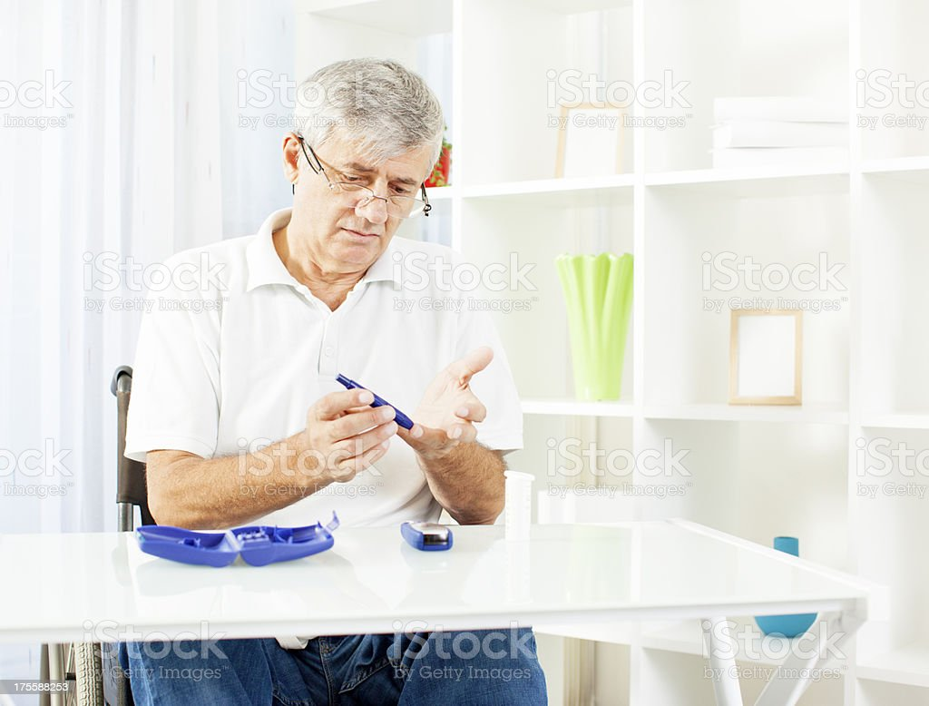 Senior Doing Blood Sugar Test. stock photo