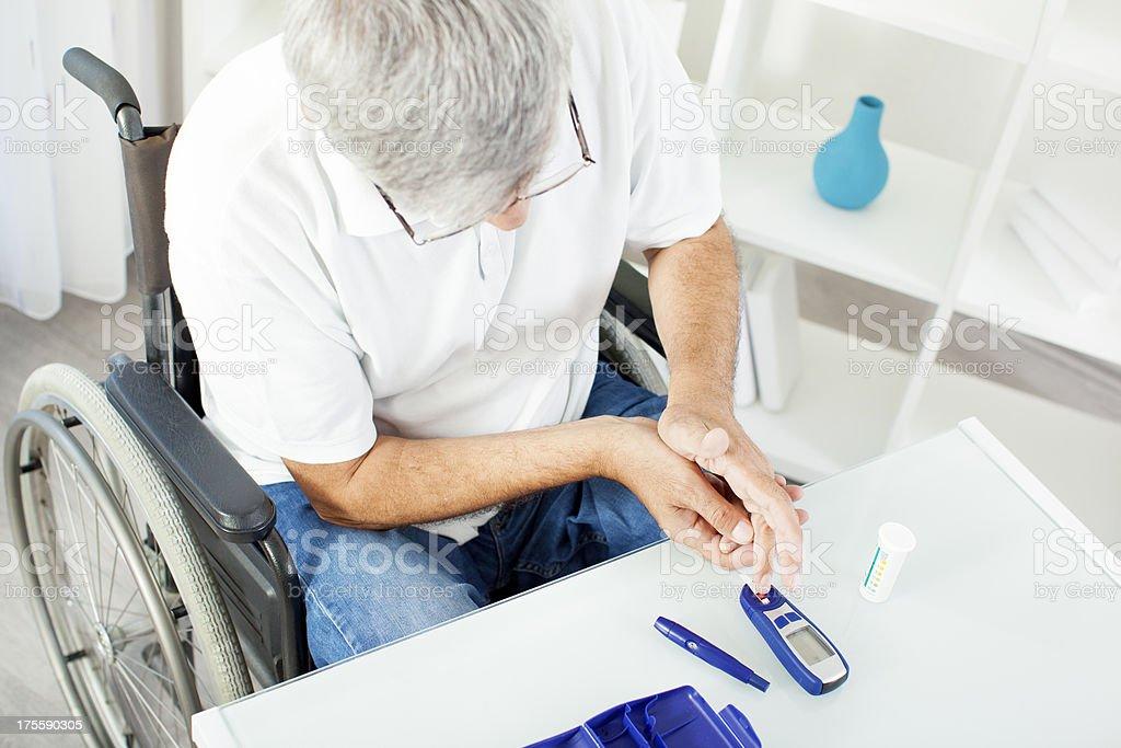 Senior Doing Blood Sugar Test. stock photo