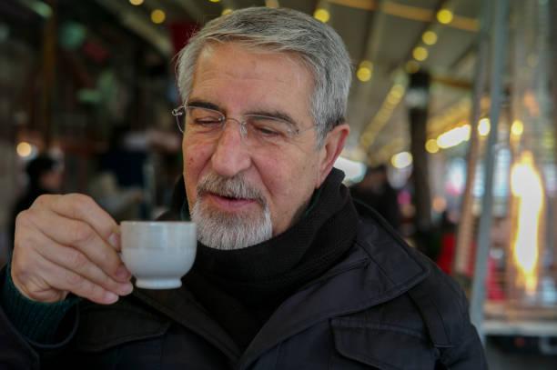 Senior drinking coffee stock photo