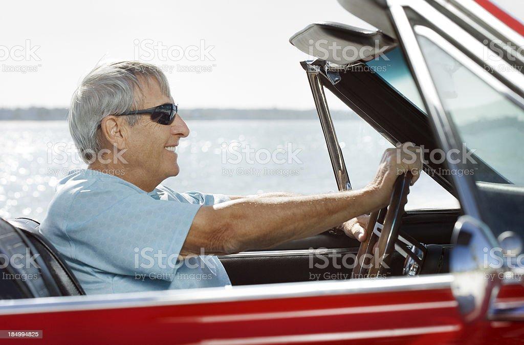 Senior driving convertible car royalty-free stock photo