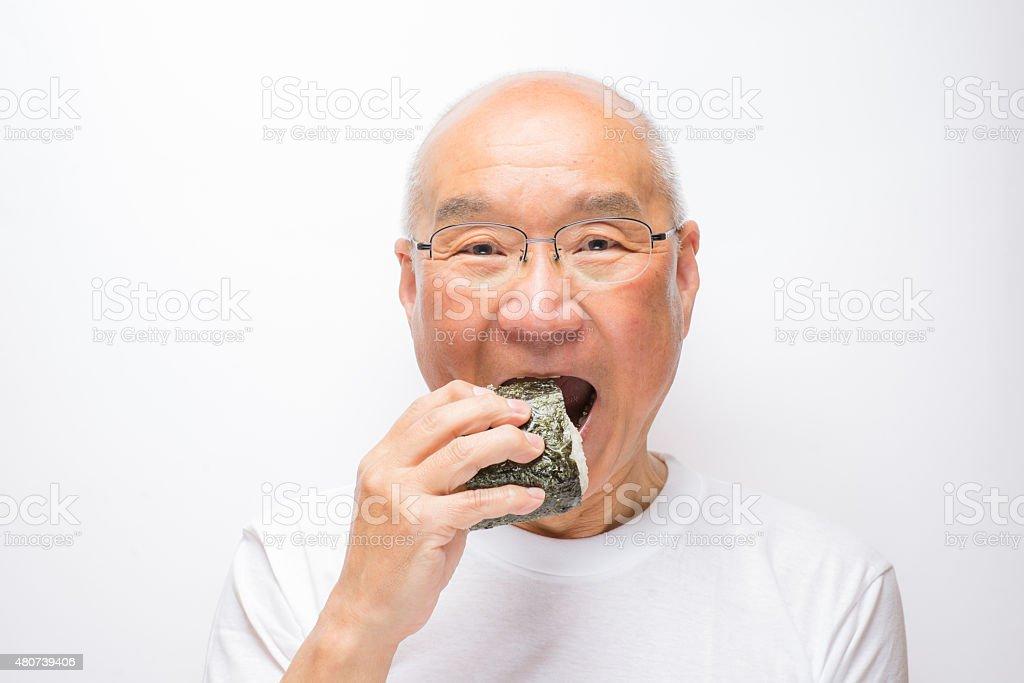 Senior eat rice balls stock photo
