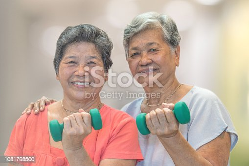 istock Senior elderly Asia woman hand holding dumbbell in physical therapy session. Healthy old people concept. 1081768500