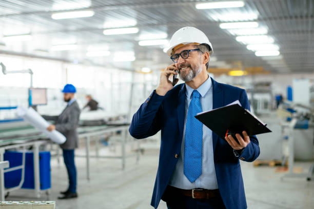 Senior engineer in a factory stock photo