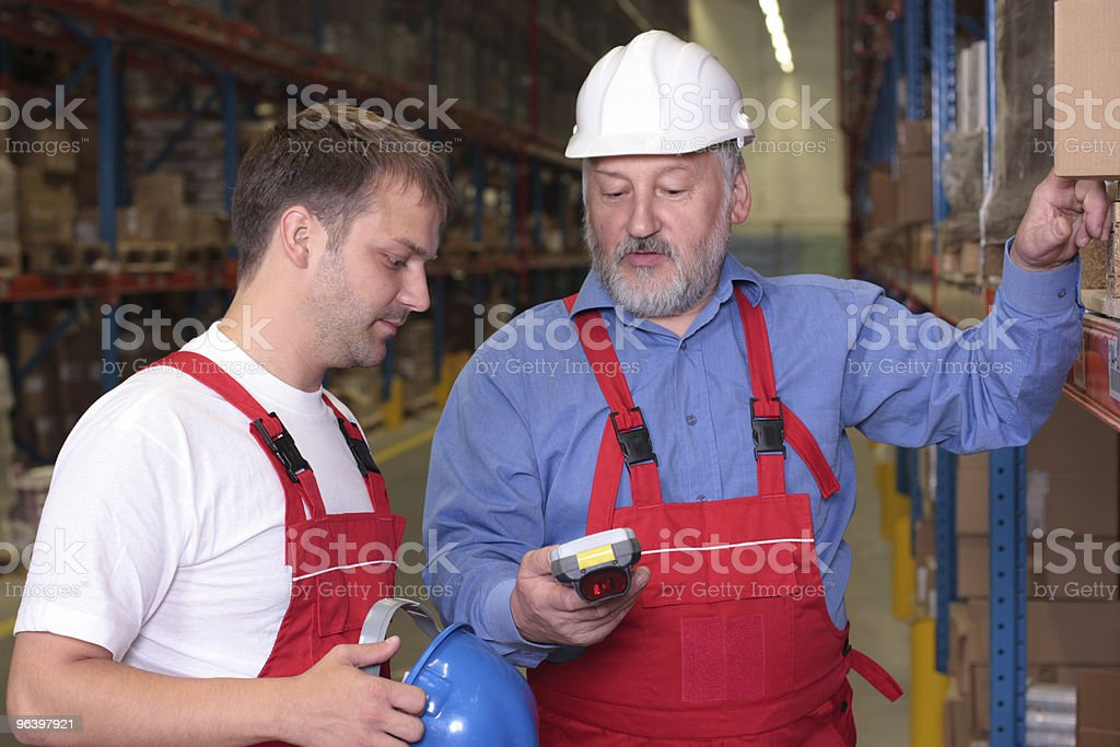 senior engineer training a newly hired employee - Royalty-free Active Seniors Stock Photo