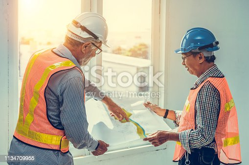 istock Senior engineers and architect working with construction plan. House building concept. 1134709955