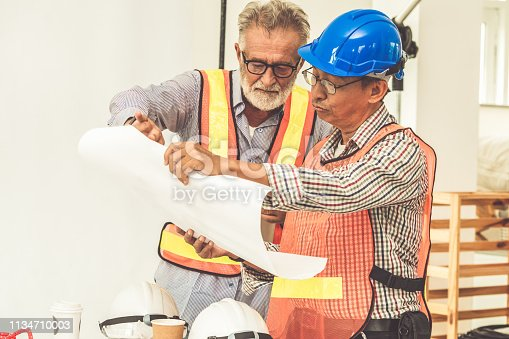 istock Senior engineers and architect working with construction plan. House building concept. 1134710003