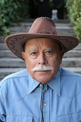 Senior ethnic cowboy with a mustache.