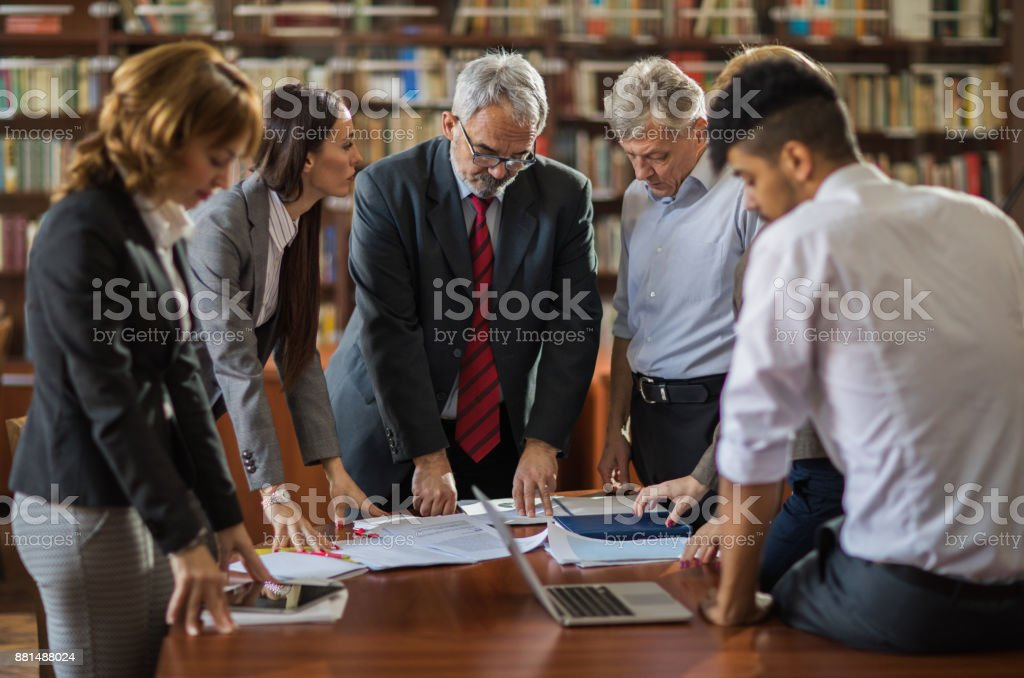 Senior executive director having a meeting with his business team in the office. stock photo