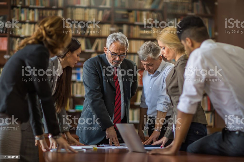 Senior executive director having a meeting with his team in the office. stock photo