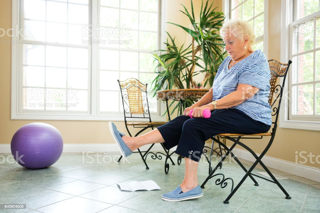 Senior exercising at home stock photo