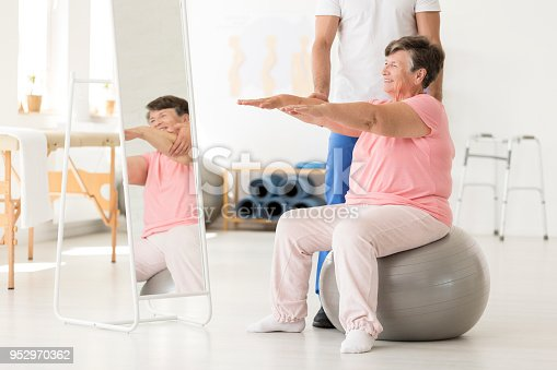 950649706istockphoto Senior exercising with physiotherapist 952970362