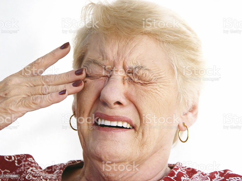 senior - eye strain / headache stock photo