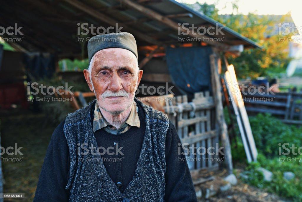 Senior Farmer standing outside barn royalty-free stock photo