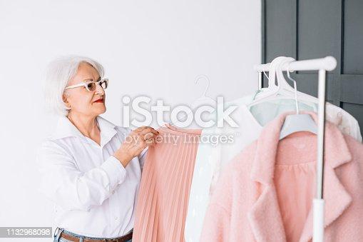 1133515238 istock photo senior fashion elegance showroom stylish clothes 1132968098