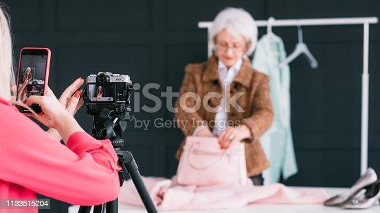 1133515238 istock photo senior fashion stylist assistant blogging business 1133515204