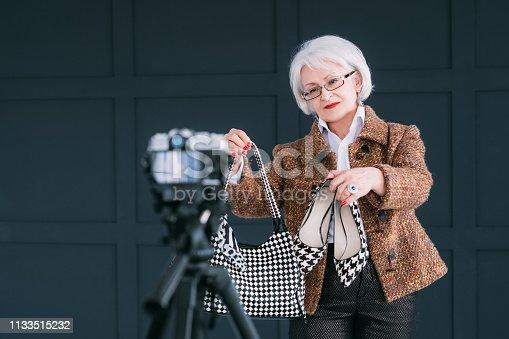 1133515238 istock photo senior fashion stylist blogger lady lifestyle vlog 1133515232