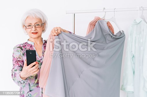 istock senior fashion stylist boutique color match advice 1135057708