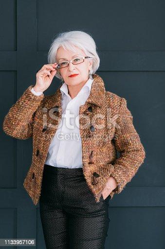 1133515238 istock photo senior fashion stylist trendy wardrobe consultant 1133957106