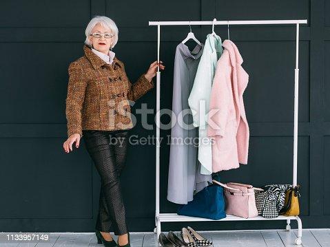 1133515238 istock photo senior fashion stylist trendy wardrobe consultant 1133957149
