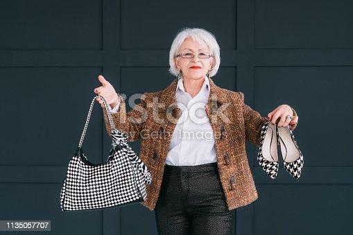 1133515238 istock photo senior fashion stylist trendy wardrobe consultant 1135057707