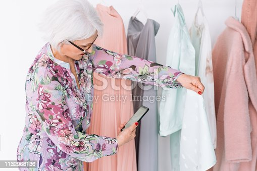 istock senior fashion stylist work successful lady vlog 1132968136