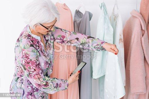 1133515238 istock photo senior fashion stylist work successful lady vlog 1132968136
