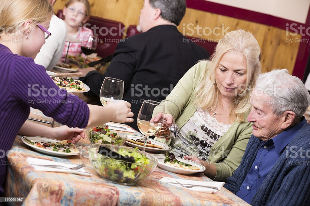 Senior father and adult daughter at a pizza restaurant royalty-free stock photo