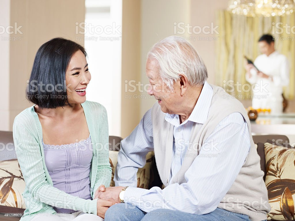 senior father and adult daughter stock photo
