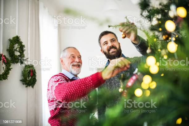 Senior father and adult son decorating a christmas tree picture id1061221938?b=1&k=6&m=1061221938&s=612x612&h=tvofvebrqprrm46xyfms6as9vrb2hvui6q68pih0hm4=