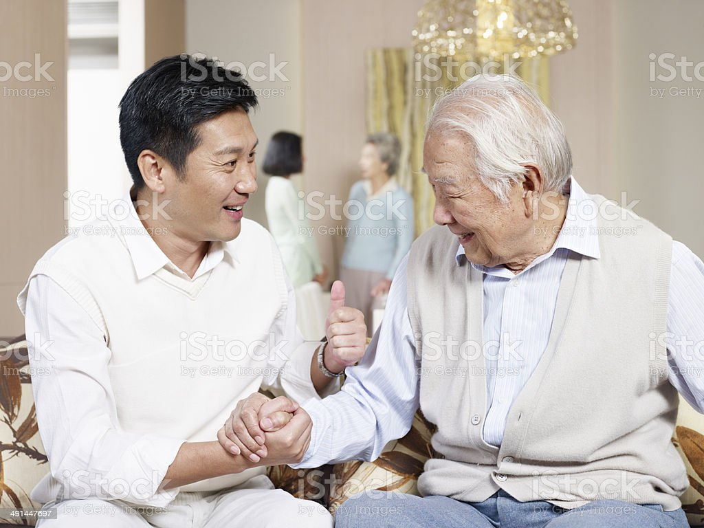 senior father and adult son royalty-free stock photo