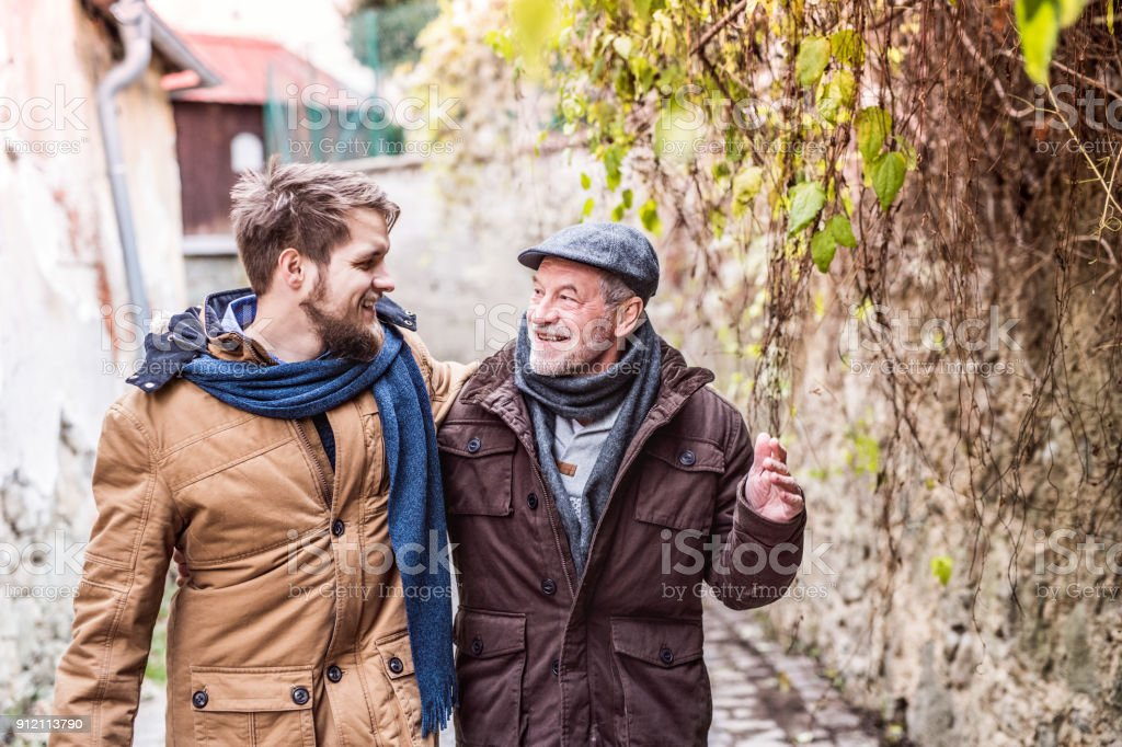 Senior father and his young son on a walk. stock photo