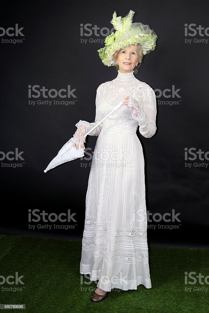 Senior Female Adult Strollng On A Lawn stock photo