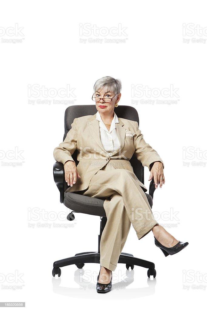 Senior Female Boss Sitting On Chair royalty-free stock photo