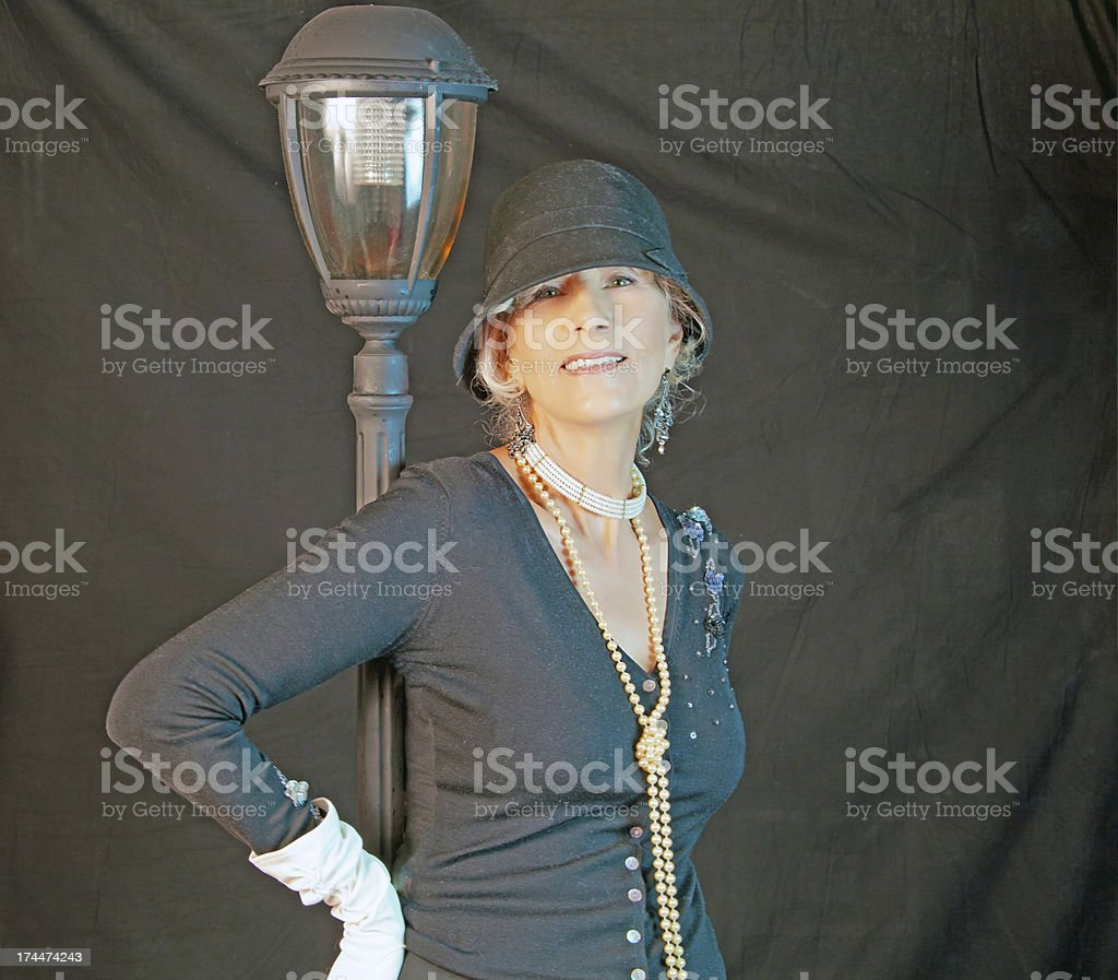 Senior Female By Lamp Post royalty-free stock photo