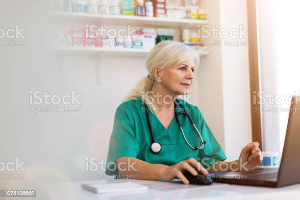 Senior female doctor using laptop in her office picture id1078108582?b=1&k=6&m=1078108582&s=612x612&h=hsiwzq v6qbkimpmvh1mfzhhpf0ybcaqbpycwfpl zw=