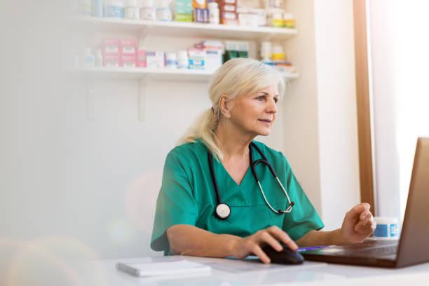 Senior female doctor using laptop in her office picture id1078108582?b=1&k=6&m=1078108582&s=612x612&w=0&h=q0y3hhavrd23qqgcov pvcn3t5zrnvkbq kmwbc4dva=