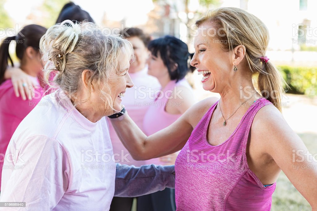 Senior female friends at charity event stock photo
